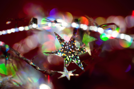 gleaming: Colorful christmas decoration with gleaming stars, silver fibre and many color bokeh circle
