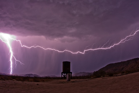 Lightning strikes near an abandoned water tank the the Anza-Borrego Desert photo