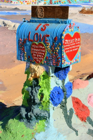 gallons: Mailbox at Salvation Mountain. Colorful artificial mountain made from adobe, straw, and thousands of gallons of donated paint.
