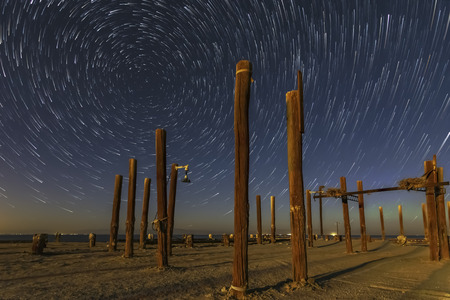 Star Trails Above Pilings at the Remains of the Salton Sea Navy Test Base Imagens