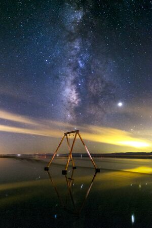 Swingset in the water and the Milky Way at the Salton Sea
