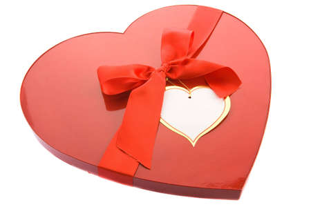 Red box as heart with ribbon on white background photo