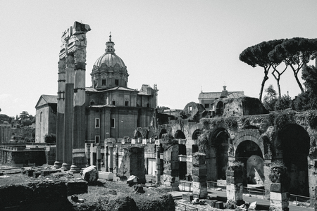 Black and white image of the ancient ruins and remnants of buildings in the Roman Forum, Rome, Italy Фото со стока