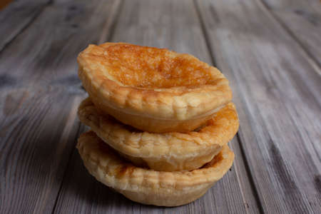 A stack of three traditional bakewell puddings Banco de Imagens