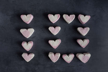 Love heart marshmallows lined up to spell out the number ten viewed from the top down Banco de Imagens
