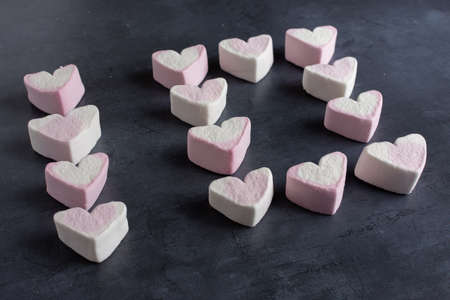 Love heart marshmallows lined up to spell out the number ten viewed from the side