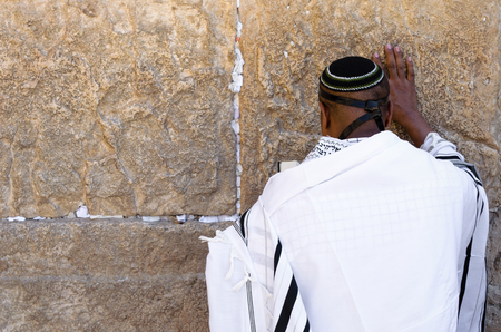 siddur: Praying man in front of Western Wall Stock Photo