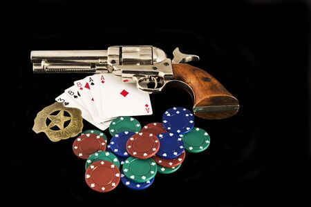 eights: Dead mans hand set up with authentic peacemaker, US marshal Badge, Chips and cards. Aces and Eights Stock Photo