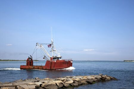 Small commercial fishing vessel. photo