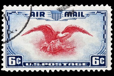postmark: Eagle holding shield, olive branch and Arrows postage stamp was issued in 1938 Stock Photo