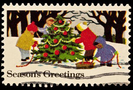 decorating christmas tree: Kids Decorating Christmas tree Issue Stock Photo