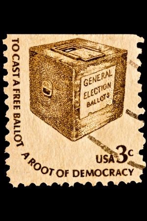 Early ballot box with slogan, To cast a free ballot a root of Democracy. Issued in 1977. photo