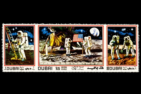 postage stamp:  Apollo 11. Men Landing and taking the first steps on the Moon July 20 1969.  First image is man taking the first step on the moon. Middle shows the planting of the American flag, astronauts and lunar modular. Third image shows the astronauts collecting r