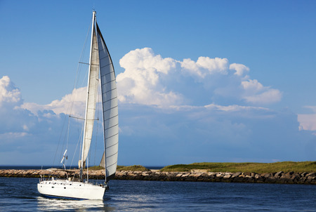 Sailboat coming in the inlet Montauk Point, Long Island , New York  Stock Photo