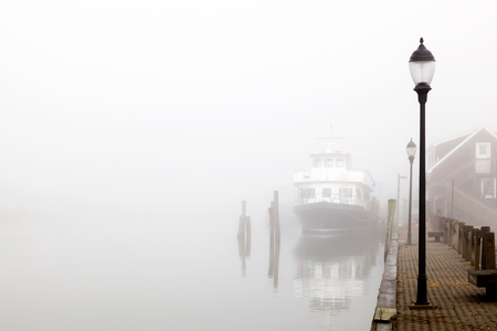 Ship Docked in the Fog  Davis park ferry docked  at Sandspit Marina, Patchogue, Long Island, New York