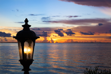 Lantern and sunset at Key Largo, Florida 스톡 콘텐츠