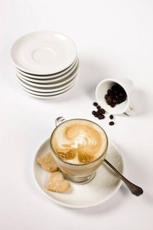 coffee and plates with coffee beans on isolated background