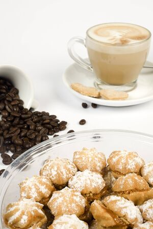 brownish: brownish coffee and spoon on isolated background