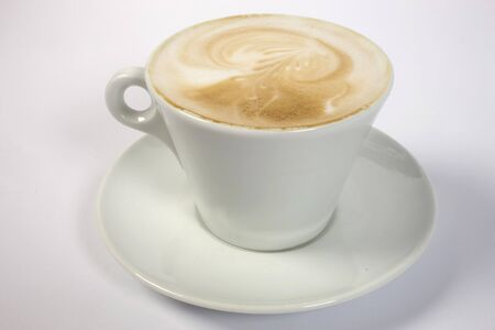 creamy: creamy coffee with plate on isolated background