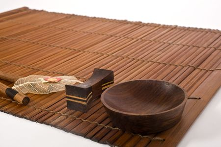 sushi mat,bowl and decorated leaf