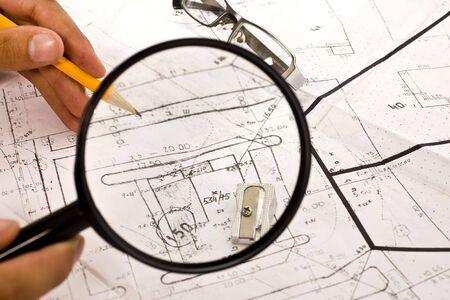 architectural studies: blueprint, lens,pencil and glasses     Stock Photo