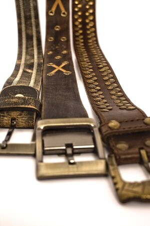 stylish belts on isolated background