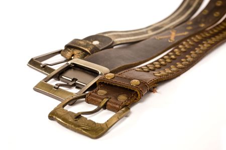 fashionable belts on isolated background