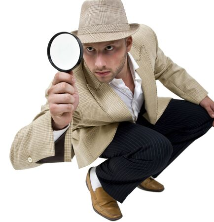 fedora: man with fedora hat and magnifier on isolatetd background