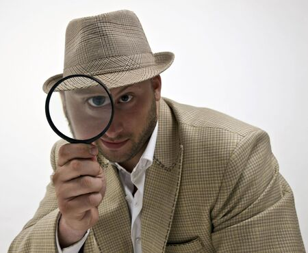spying man with magnifying glass on isolated background