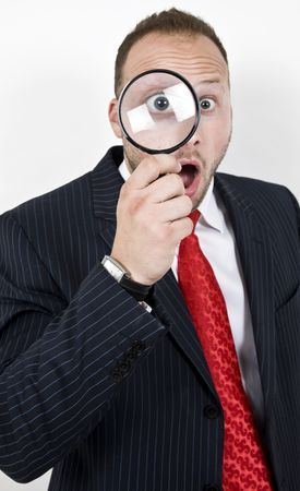 man with magnified eyes on isolated background   Stock Photo