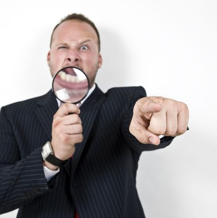 investigators: male pointing with magnifying glass   Stock Photo