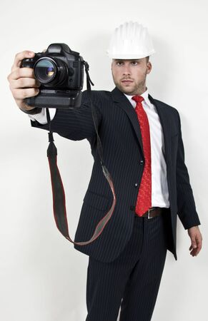 engineer with camera on isolated background