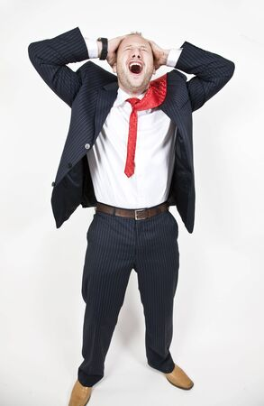 shocked businessman on isolated background   Stock Photo