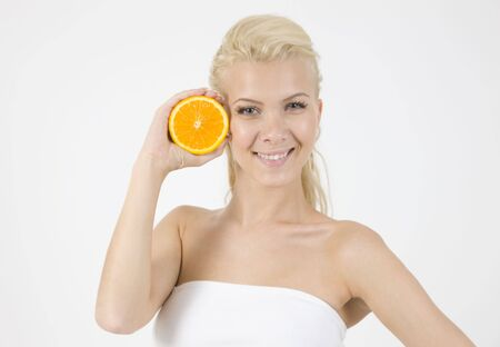 waistup: waist-up pose of model with slice of orange on isolated studio pictures