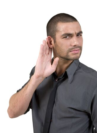 young man hard of hearing holds hand up to ear to listen