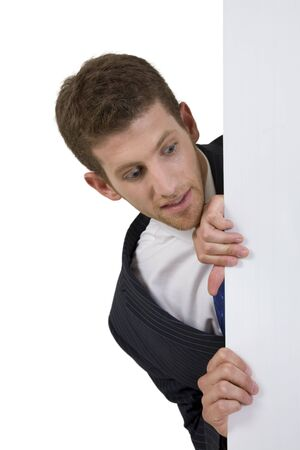 man peeping side white board on isolated background Stock Photo - 3567202