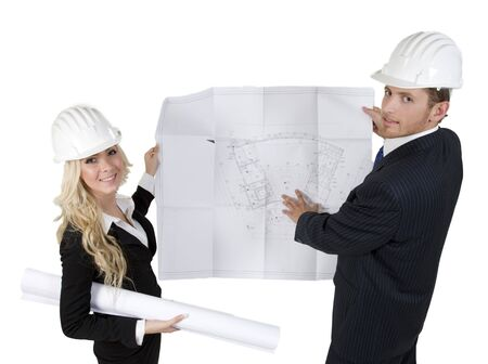 engineers reviewing blueprint on isolated background Stock Photo