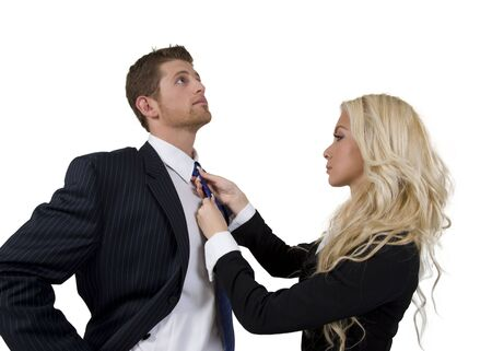 lady knotting tie of man on isolated background Stock Photo