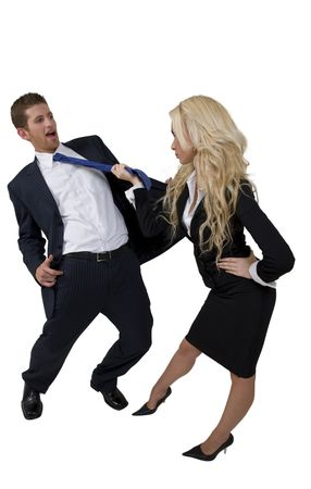 female pulling tie of man on isolated background Stock Photo
