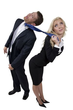 female pulling tie of businessman on isolated background Stock Photo