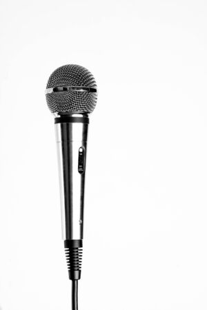 Silver microphone with black wire isolated on white photo