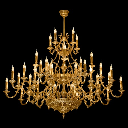 Vintage chandelier isolated on black background with clipping path photo