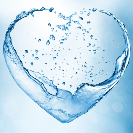 Heart from water splash with bubbles photo