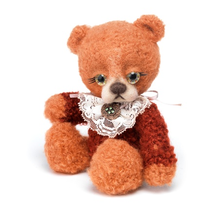 Teddy bear in classic vintage style isolated on white background photo
