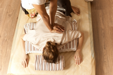 female receiving professional thai massage