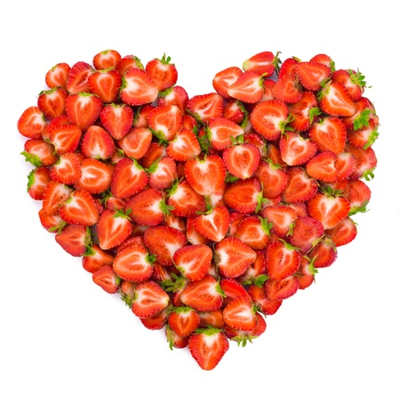 Heart shape by sliced strawberries. Valentine heart. photo