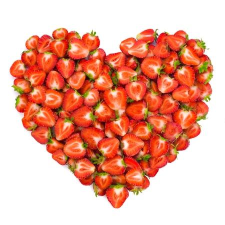 Heart shape by sliced strawberries. Valentine heart. photo