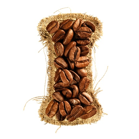 Alphabet from coffee beans on fabric texture isolated on white background Stock Photo - 17468126