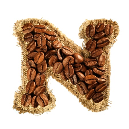 Alphabet from coffee beans on fabric texture isolated on white background Stock Photo - 17468191