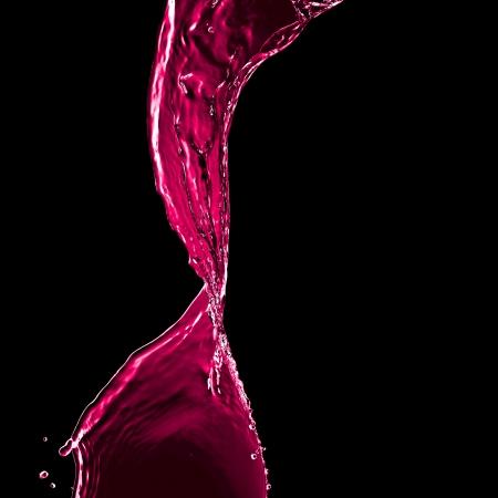fluids: pink splash isolated on black